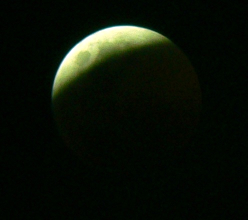 The moon during an eclipse, showing just a thin sliver left