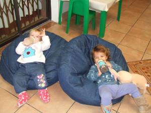 children taking a break on bean bags